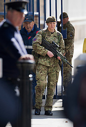 © London News Pictures. 23/05/2013. Woolwich, UK. A female soldier on guard outside  Woolwich Military Barracks in Woolwich, London where a member of the armed forces was attacked yesterday (22/05/2013) by two men in what is being described as a terrorist attack. Photo credit: Ben Cawthra