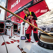 Leg 02, Lisbon to Cape Town, day 12, on board MAPFRE, Sophie Ciszek triming the main sail. Photo by Ugo Fonolla/Volvo Ocean Race. 16 November, 2017