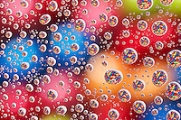 Water Droplets on Glass over multi-colored Skittles