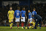 Bristol Rovers Defender, Tom Lockyer (4) on the ground after a clash with Portsmouth Forward, Omar Bogle (22) during the EFL Sky Bet League 1 match between Portsmouth and Bristol Rovers at Fratton Park, Portsmouth, England on 19 February 2019.