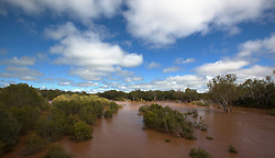 A shaft of sunlight lights the Fitzroy River at Willare in the wet season.  In full flood, the river flows at 30,000 cubic meters per second.