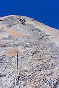 Climber on Stately Pleasure Dome in the Tuolumne Meadows area, Yosemite National Park, California