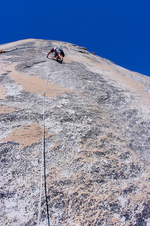 Climber on Stately Pleasure Dome in the Tuolumne Meadows area, Yosemite National Park, California