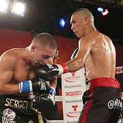 Cosme Rivera (R) punches Sergei Lipinets during a Telemundo Boxeo boxing match at the A La Carte Pavilion on Friday,  March 13, 2015 in Tampa, Florida.  Lipinets won the bout. (AP Photo/Alex Menendez)