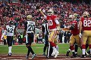 San Francisco 49ers quarterback Jimmy Garoppolo (10) celebrates scoring a touchdown during the first quarter against the Jacksonville Jaguars at Levi's Stadium in Santa Clara, Calif., on December 24, 2017. (Stan Olszewski/Special to S.F. Examiner)