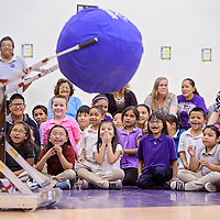 041614       Cable Hoover<br /> <br /> Students at Tobe Turpen Elementary School laugh and cheer as a robot from the Gallup High School robotics team lifts a giant ball during an assemble at Tobe Turpen Elementary School Wednesday.