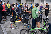 Members of the London Brompton Club pause in Marchmont Street during an afternoon tour of the capital on their foldaway bikes, on 26th September 2021, in London, England. The London Brompton Club (LBC) is a cycling group for owners & enthusiasts of Brompton folding bicycles - the UK's largest bike manufacturer. They have members from all across the UK come & take part in nationwwide rides.