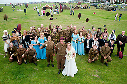 """""""Caps off"""" And Hacking and Kath Plummer, both reenactors with the Northern World War 2 Assocition  chose to tie the knot surrounded by family and friends at Saint John The Divine Church Lytham, during the Lytham 1940's war weekend.19 August 2011  Image © Paul David Drabble."""