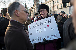 © Licensed to London News Pictures. 26/03/2018. London, UK. Supporters of Jemery Corbyn hold a counter demonstration as members of the Jewish community, Jewish leaders and supporters hold a demonstration outside the Houses of Parliament in London against Jeremy Corbyn, who they accuse of not acting on anti-semitic behaviour in the Labour Party. Photo credit: Ben Cawthra/LNP