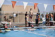 """Kern County resident Hayden Gamino, 8, waits his turn to dive during swim practice. Gamino's mother was advised by a doctor to get him in to swimming to help with his asthma. """"It feels like a wasp stinging my lungs,"""" said Gamino of the asthma attacks he suffers."""