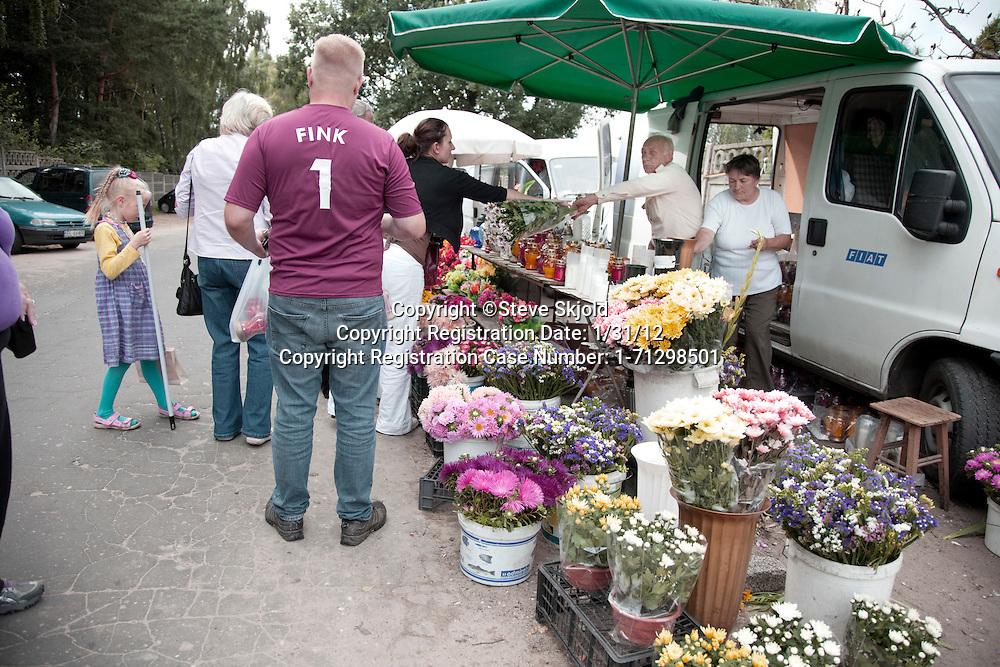 Purchasing flowers outside the gates. Roman Catholic Church's Cemetery Cmentarz Rzymskokatolicki Lodz Central Poland