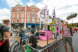"""© Licensed to London News Pictures;31/08/2020; Bristol, UK. Extinction Rebellion protest through Bristol's city centre urging local MPs to support the upcoming Climate and Ecological Emergency Bill. The protest is part of a bank holiday weekend of protest action titled """"Bristol Rebellion: We Want To Live"""". XR are protesting in Bristol and other cities in the UK against climate change, leading up to a protest in London starting on 01 September. XR say that despite clear scientific evidence of the deadly climate and ecological emergency, the UK government are refusing to take the urgent action needed to avoid mass extinction. XR say we need politicians to support the Climate and Ecological Emergency Bill. During the coronavirus covid-19 pandemic, climate change is being forgotten but it is still an emergency that is happening, the elephant in the room. Photo credit: Simon Chapman/LNP."""