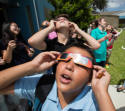 August 21, 2017 - Boynton Beach, Florida, U.S. - Isaac Frishberg, seventh grader at Christa McAuliffe Middle School reacts to seeing the partial eclipse with protective glasses provided by the school in Boynton Beach, Florida on August 21, 2017. (Credit Image: © Allen Eyestone/The Palm Beach Post via ZUMA Wire)