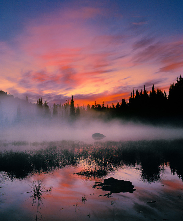 Ground fog is enhanced by surise light at Sisters Mirror Lake in Cascades Range of Oregon.