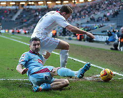 Milton Keynes Dons' Lee Hodson is challenged by Tranmere Rovers' Ryan Lowe - Photo mandatory by-line: Nigel Pitts-Drake/JMP - Tel: Mobile: 07966 386802 01/02/2014 - SPORT - FOOTBALL - Stadium MK - Milton Keynes - MK Dons v Tranmere Rovers - Sky Bet League One
