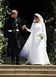 File photo dated 19/05/18 of The Duchess of Sussex, formerly Meghan Markle, in a Givenchy dress, leaving St George's Chapel with the Duke of Sussex after their wedding. A bridal expert has suggested that Princess Eugenie should opt for an elegant and simple wedding dress to create a memorable royal look, rather than going for over-the-top drama.