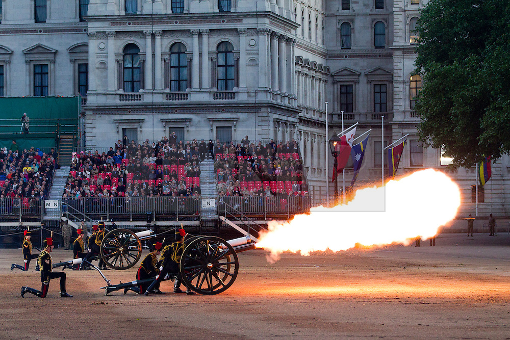 © Licensed to London News Pictures. 13/06/2013. London, UK. Performing for Her Majesty the Queen, members of the Kings Troop Royal Horse Artillery fire their guns as part of a mock battle celebrating the British Army's 1813 victory at the Battle of Vitoria during the annual Beating Retreat parade at Horse Guards Parade in London. On two successive evenings each year in June a pageant of military music, precision marching and colour takes place on Horse Guards Parade in the heart of London when the Massed Bands of the Household Division carry out the Ceremony of Beating Retreat. 300 musicians, drummers and pipers perform this age-old ceremony. The Retreat has origins in the early days of chivalry when beating or sounding retreat pulled a halt to the days fighting. Photo credit: Matt Cetti-Roberts/LNP