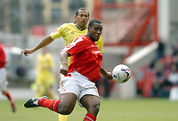 Photo: Leigh Quinnell.<br /> Nottingham Forest v Colchester United. Coca Cola League 1. 08/04/2006. Colchesters Chris Iwelumo can only watch as Forests Wes Morgan clears the ball.
