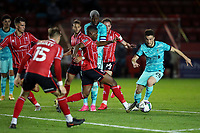 Football - 2020 / 2021 EFL Carabao Cup - Round Three - Lincoln City vs Liverpool<br /> <br /> Diogo Jota of Liverpool and Tayo Edun of Lincoln City, at the LNER Stadium.<br /> <br /> COLORSPORT/PAUL GREENWOOD