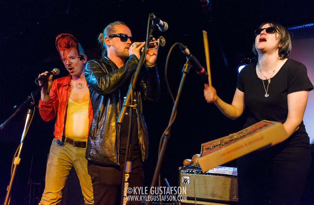 WASHINGTON, DC - March 21st, 2014 - Toby Goodshank (dressed as David Bowie), Macaulay Culkin and Deenah Vollmer of the Pizza Underground perform at the Black Cat in Washington, D.C. (Photo by Kyle Gustafson / For The Washington Post)