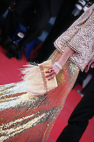 Olivia Palermo in a gold dress with a pretty feather trimmed bag at The Immigrant film gala screening at the Cannes Film Festival Friday 24th May May 2013