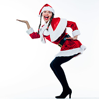 one woman dressed as santa claus product placement showing empty hand on studio isolated white background
