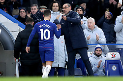 Chelsea's Eden Hazard (left) is congratulated by Chelsea manager Maurizio Sarri as he is substituted towards the end of the Premier League match at Stamford Bridge, London.