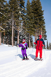 California: Northstar at Lake Tahoe, couple snowshoeing.    Photo copyright Lee Foster.  Photo # cataho100343