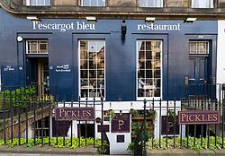View of L'escargot Bleu restaurant and Pickles of Broughton Street wine bar on Broughton Street in Edinburgh New Town, Scotland, UK