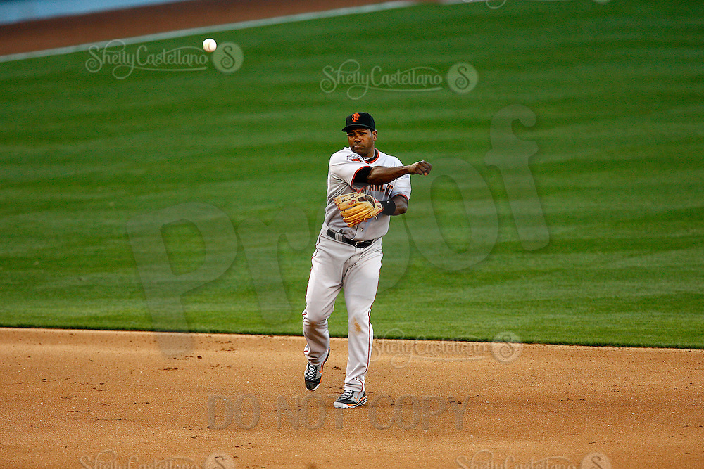 31 March 2011:  Shortstop #10 Miguel Tejada throws the ball as the San Francisco Giants were defeated 2-1 by the Los Angeles Dodgers  during a sold out game at Dodger Stadium in Los Angeles, California on opening day..***** Editorial Use Only *****
