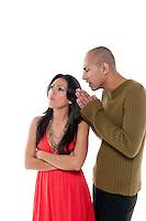Young couple having an argue and boyfriend asking pardon.