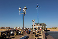 NC01400-00...NORTH CAROLINA - The busy deck of Jennettes Pier and a surf competition on the Outer Banks at Nags Head.