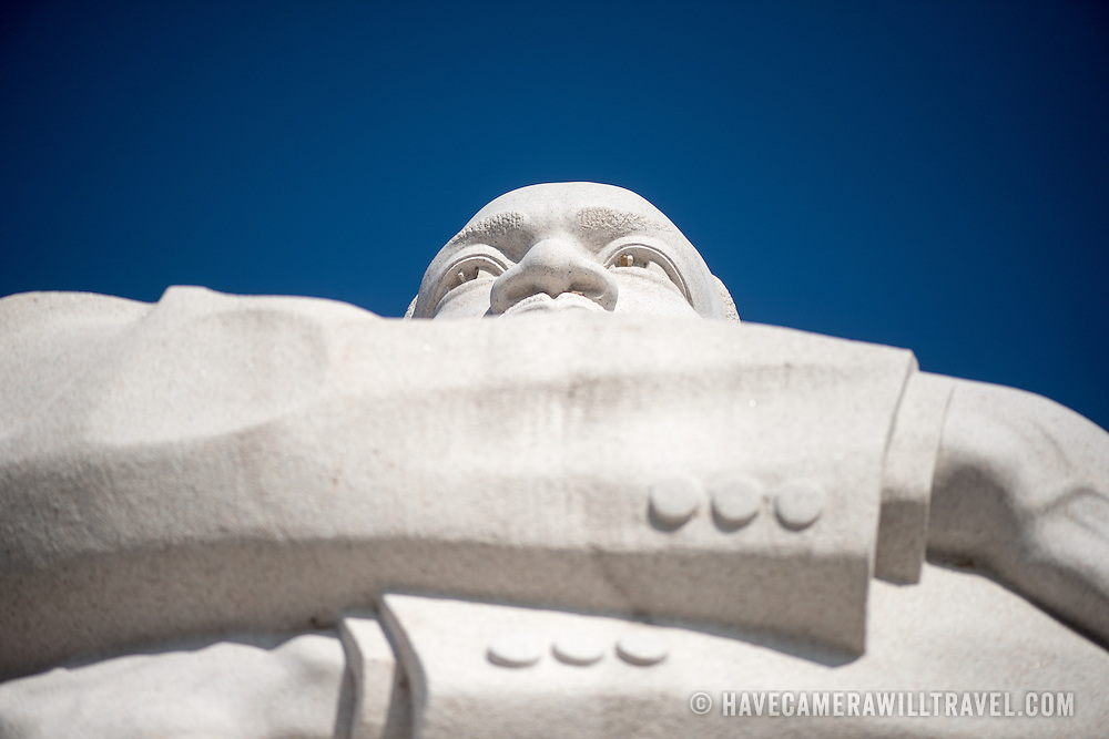 Looking up from below at the statue of Dr Martin Luther King Jr that is part of the Stone of Hope at the heart of the MLK Memorial in Washington DC. The statue was carved by Chinese sculptor Lei Yixin.