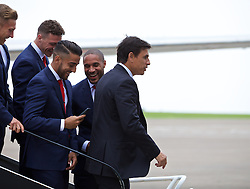 CARDIFF, WALES - Saturday, June 4, 2016: The Wales captain Ashley Williams jokes with Neil Taylor as the squad prepares for a team photograph on the steps of the aircraft as they are given a send off at Cardiff Airport as they head to Sweden for their last friendly before the UEFA Euro 2016 in France. (Pic by Paul Greenwood/Propaganda)