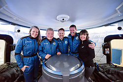 Handout photo dated October 12, 2021 of the crew of NS-18, Audrey Powers, William Shatner, Dr. Chris Boshuizen, and Glen de Vries, with CrewMember 7 Sarah Knights. Hollywood actor William Shatner has become the oldest person to go to space as he blasted off aboard the Blue Origin sub-orbital capsule. The 90-year-old, who played Captain James T Kirk in the Star Trek films and TV series, took off from the Texas desert with three other individuals. Mr Shatner's trip on the rocket system - developed by Amazon.com founder Jeff Bezos - lasted about 10 minutes. Photo by Blue Origin via ABACAPRESS.COM