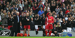 LIVERPOOL, ENGLAND - SUNDAY MARCH 27th 2005: Liverpool Legends' Kenny Dalglish prepares to come on as a substitute against a Celebrity XI during the Tsunami Soccer Aid match at Anfield. (Pic by David Rawcliffe/Propaganda)