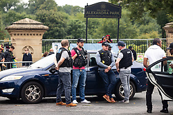 © Licensed to London News Pictures . 12/08/2018. Manchester , UK . Police outside the entrance to the park . The second day of the annual Caribbean Carnival in Alexandra Park in Moss Side , celebrating music , food and Afro-Caribbean culture . A nearby shooting overnight lead to at least ten people injured . Ten people are in hospital . Photo credit : Joel Goodman/LNP