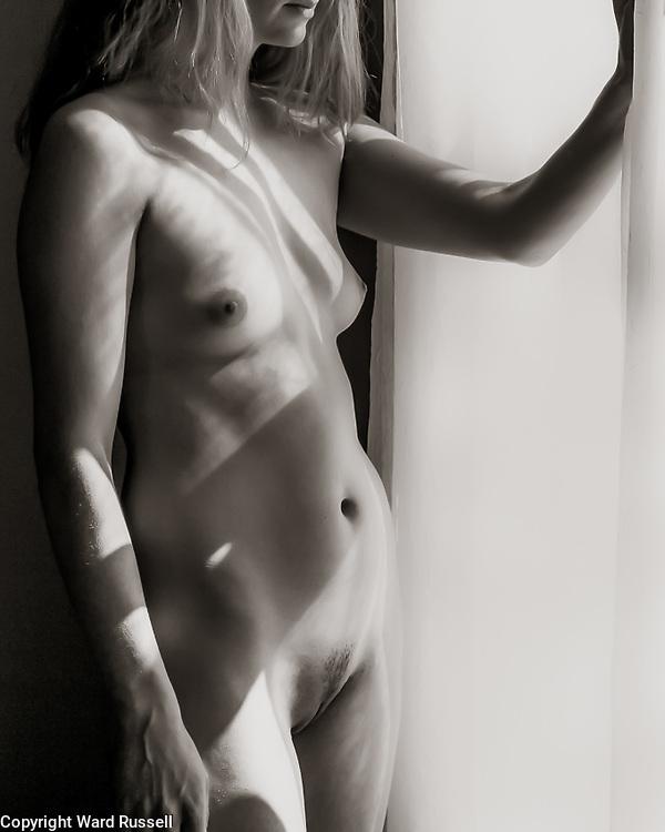 Nude posing frontal.