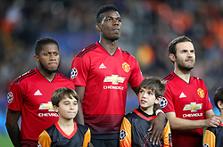 (left to right) Manchester United's Fred, Manchester United's Paul Pogba and Manchester United's Juan Mata line up ahead of the match