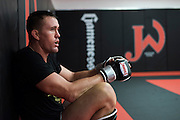 UFC welterweight Kyle Noke of Australia catches his breath between sparing rounds at Jackson Wink MMA in Albuquerque, New Mexico on June 9, 2016.