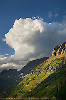 Clouds and the Garden Wall bathed in evening light, Glacier National Park Montana USA