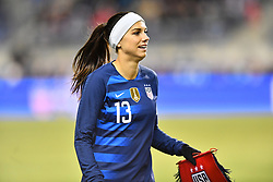 February 27, 2019 - Chester, PA, U.S. - CHESTER, PA - FEBRUARY 27: US Forward Alex Morgan (13)carries a team banner to exchange before the She Believes Cup game between Japan and the United States on February 27, 2019 at Talen Energy Stadium in Chester, PA. (Photo by Kyle Ross/Icon Sportswire) (Credit Image: © Kyle Ross/Icon SMI via ZUMA Press)