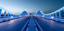 Illuminated bridge at Meydan in Dubai United Arab Emirates