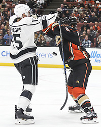 November 7, 2017 - Los Angeles, California, U.S - Los Angeles Kings forward Andy Andreoff (15) and Anaheim Ducks defenseman Brandon Montour (26) fight for the puck during a 2017-2018 NHL hockey game in Anaheim, California on Nov. 7, 2017. Los Angeles Kings won 4-3 in overtime. (Credit Image: © Ringo Chiu via ZUMA Wire)