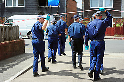 © Licensed to London News Pictures. 08/08/2018<br /> Deptford, UK. A police search team outside a property where 7 year Joel Urhie was killed in a suspicious house fire at Adolphus Street, Deptford.  <br /> Photo credit: Grant Falvey/LNP