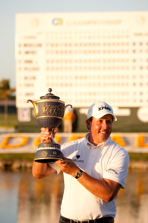 DORAL, FL - MARCH 15:  Phil Mickelson holds the trophy in front of the scoreboard after winning the 2009 WGC-CA Championship at Doral Golf Resort and Spa in Doral, Florida on Sunday, March 15, 2009. (Photograph by Darren Carroll) *** Local Caption *** Phil Mickelson