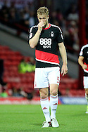Nottingham Forest defender Matthew Mills (5) with hand on face during the EFL Sky Bet Championship match between Brentford and Nottingham Forest at Griffin Park, London, England on 16 August 2016. Photo by Matthew Redman.
