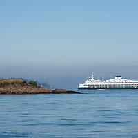 A statue on a rocky island on the south side of Bainbridge Island, Washington. Photo by William Drumm.