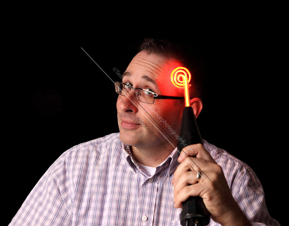 A quack medical device used to restore hair, cure cancer, increase intelligence, and cure gout.  The device is actually a Tesla coil used to excite a tube filled with low pressure neon gas.  The device had no medical advantages.  This device was sold under a number of name including the Violet ray.  Sold from the 1930's until the late 1970's..