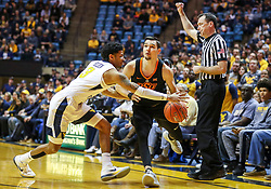 Jan 12, 2019; Morgantown, WV, USA; Oklahoma State Cowboys guard Thomas Dziagwa (4) draws a foul from West Virginia Mountaineers guard James Bolden (3) during the first half at WVU Coliseum. Mandatory Credit: Ben Queen-USA TODAY Sports